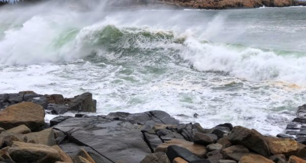photo of waves crashing in arey cove on maine coast