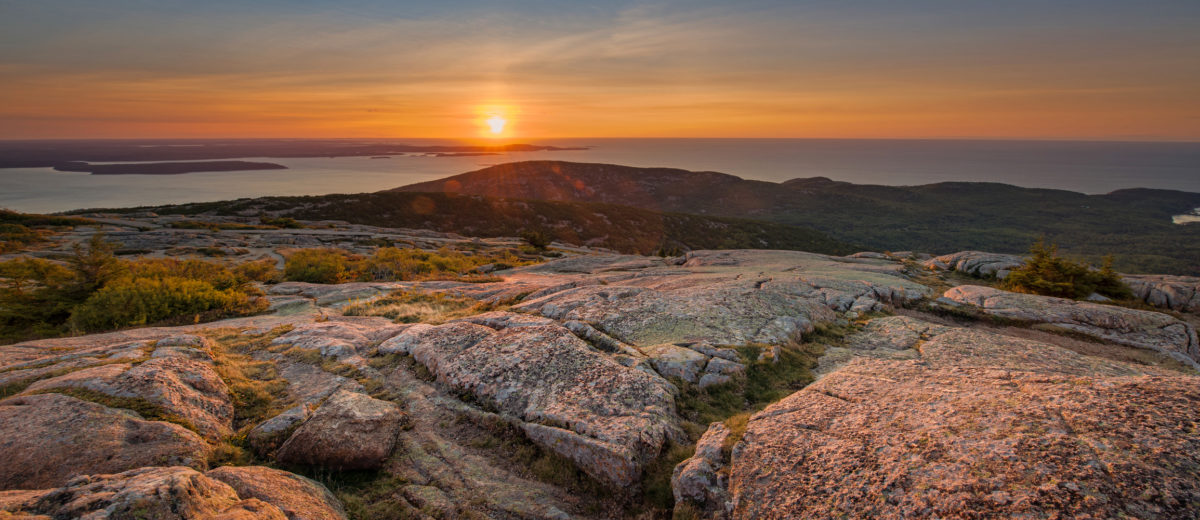 Warm sun hitting the mountain rock in Acadia National Park, Maine.