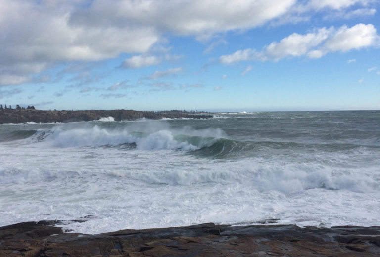 photo of waves crashing on maine's rocky shore