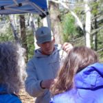 Forest ecologist Nick Fisichelli holds a bare-root white pine seedling.