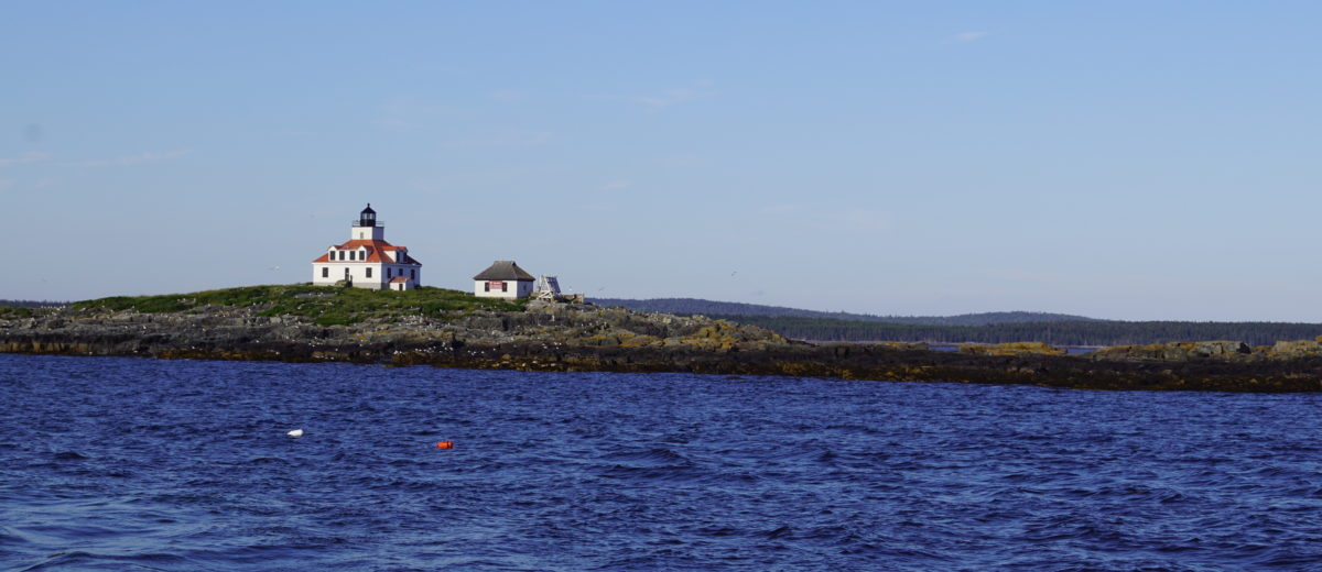 photo of lighthouse on maine rocky coast