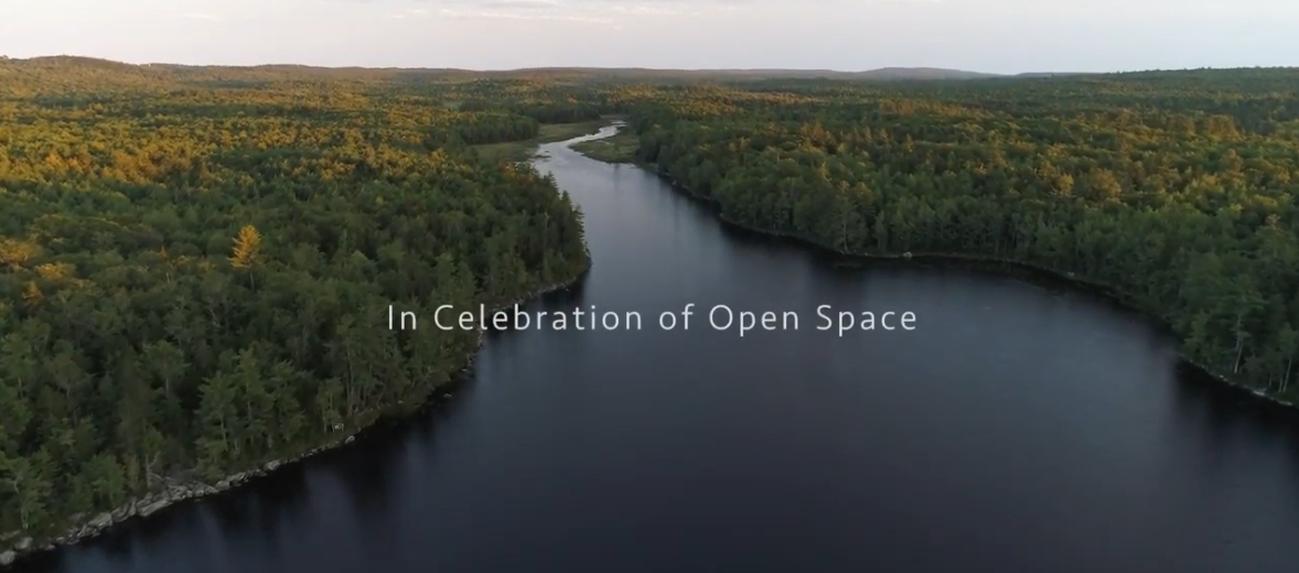 "aerial photograph of maine river with words overlay ""in celebration of open space"""