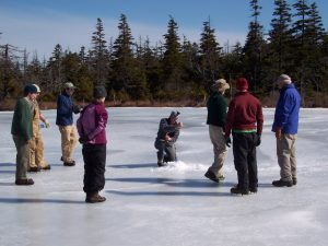Eight scientists drill through the ice on Sargent Mountain Pond