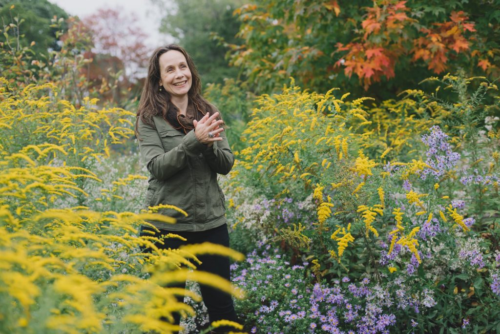 Deb Perkins in flowering garden